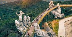 The jaw-dropping Golden Bridge of Da Nang Vietnam is a thing of beauty. Two giant hands meant to be the hands of a god cradle a strand of gold which serves as the walkway. The impressive bridge only enhances the views of the surrounding Ba Na Hills. Us Destinations, Amazing Destinations, Da Nang, Beautiful Places In The World, Places Around The World, Sequoia, Natural Wonders, Asia Travel, Vietnam Travel