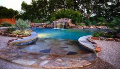 stone edged pool with waterfall.