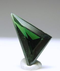 A triangular gem of Gahnite, a green Spinel colored by the presence of Zinc.
