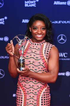 Simone Biles Photos Photos - Winner of the Laureus World Sportswoman of the Year Award.Gymnast Simone Biles of the US.poses with her trophy the Winners Press Conference and Photocall during the 2017 Laureus World Sports Awards at the Salle des Etoiles,Sporting Monte Carlo on February 14, 2017 in Monaco, Monaco. - Winners Press Conference and Photocalls - 2017 Laureus World Sports Awards - Monaco