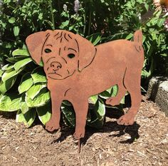 Puggle Garden Stake or Wall Hanging. This handcrafted Puggle Garden Stake or Wall Hanging will become a decorative favorite. A charming way to add some fun to your home or garden decor. Approximately 19 inch diameter. Only rustic and black colors are in stock, all other colors are made to order. The rustic patina also varies on each piece. Looking for different styles? Check out our Puggle Plant Stake & Christmas Ornament by following the link provided:...