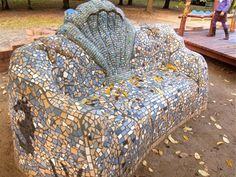 Here is more of the wonderful work of the artist and earthen sculptor Rainer Warzecha [http://www.interglotz.de/engl/e_vita]. This adobe and cob bench sits in the same Berlin park as the magnificent elephant also in this gallery. Rainer works with clay and natural materials creating huge sculptures, big wall paintings, murals and legal graffiti.