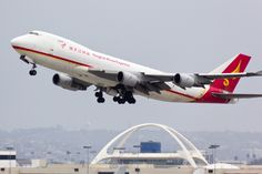 A photo of a Yangtze River Express Boeing 747-409F airplane taking off from Los Angeles (LAX / KLAX). The aircraft registration is B-2431
