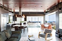 The Ettley Residence by Stuido 9one2. Cozy and modern - whodathunkit.