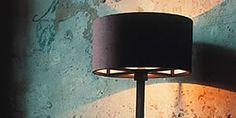 The Penta Light Wood table lamp from the Italian Penta Lighting Collection is mounted luminaire that is great for halogen lighting. The Wood is a rounded or squared table lamp in wood stained wenge, bleached oak or honey color. For more information on this Table Lamp visit the website.
