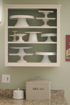 builders grade cabinets turned into quick and BEAUTIFUL open shelves. Loving the cake plate collection!
