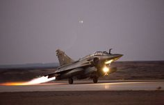 Photo EMA. French Armée de l'Air Dassault Mirage 2000D takes off from an airbase in Jordan, for a night strike against IS targets in Iraq, March 2015.