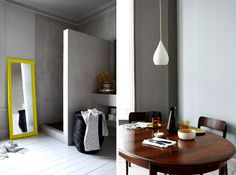 cement shower next to a bright yellow mirror ... Love