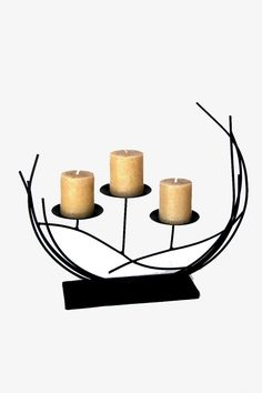 "Elegant metal candle holder 17"" x 16"" high. Would make a excellent focal point for console or coffee table. Candles not included.   Candle Holder by Expressions. Home & Gifts - Home Decor - Decorative Objects Canada"