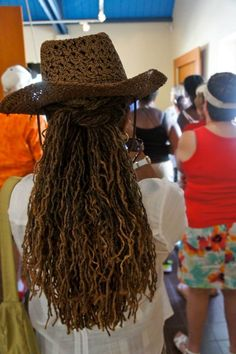 #long seasoned Sisterlocks with golden tones