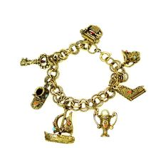 Gold Tone Charm Bracelet Etruscan Revival Style from claraschicboutique on Ruby Lane