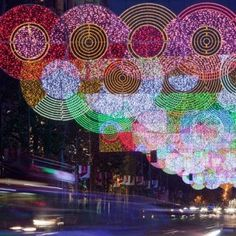 Christmas shoppers in Madrid can stroll under glittering circles of LEDs designed by Italian architect Teresa Sapey Holiday Lights, Christmas Lights, Merry Christmas, Holiday Decor, Les Illuminations, Eco Architecture, Christmas Wonderland, Oui Oui, Light Installation