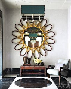 This astonishing mirror is Italian, from the 1960s. It's shown in an apartment decorated by Steven Gambrel.