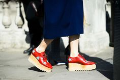Star patchwork embroidered Elyse lace up wedge shoes from the Stella McCartney Winter '14 collection on the street in London. Photo by Adam Katz Sinding, courtesy of W Magazine.