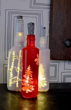 Illuminate your home at Christmas with this simple Christmas bottle lights. They would also make a lovely Christmas gift. Glitter Wine Bottles, Christmas Wine Bottles, Lighted Wine Bottles, Bottle Lights, Glass Lights, Beer Bottles, Vodka Bottle, Diy Christmas Lights, Decorating With Christmas Lights