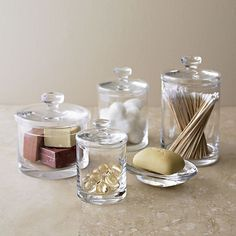 Glass canisters in bath accessories crate and barrel Retro Home Decor, Home Decor Store, Diy Home Decor, Bathroom Jars, Simple Bathroom, Bathroom Storage, Gold Bathroom, Rental Bathroom, Bathroom Stuff