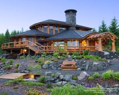 Round log post and beam home in Washington.  For more photos or this or any…