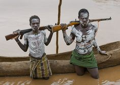 Young Karo Men With White Painted Faces And Chests Holding Kalashnikov Rifle In Omo River , Omo Valley Ethiopia by Eric Lafforgue, via Flickr