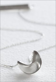 Sterling Silver Fortune Cookie Necklace ($76) features a hand-stamped personalized message hidden at the clasp. Each necklace is hand-crafted by Designer Kristina Kober (http://www.etsy.com/shop/christinakober?ref=seller_info).