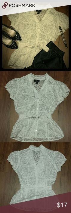 Kohl's IZ Byer California zebra sheer ruffle top L Soft meets edgy with this IZ Byer California sheer zebra print blouse with ruffle detail, matching belt, button down,  excellent pre-owned condition, worn a handful of times,  one belt loop came partial detached.   Top only. See separate listing(s) for other item(s). Iz Byer Tops Button Down Shirts