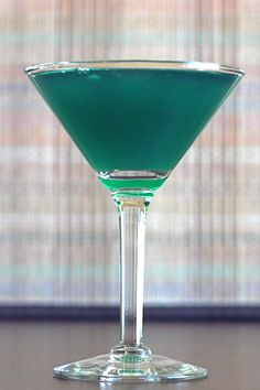 Seaweed Drink recipe with Midori, blue curacao, Malibu Rum, orange juice and citrus.