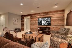 Family Room Decor Family Room a wood plank wall uh yes! Maybe in the Family Room Decor Family Room a wood plank wall uh yes! Maybe in the spare room? The post Family Room Decor Family Room a wood plank wall uh yes! Maybe in the appeared first on Wood Diy. Wood Plank Walls, Pallet Walls, Wood Paneling, Wall Wood, Paneling Ideas, Wood Planks, Planked Walls, Wood Beams, Man Cave Wood Walls