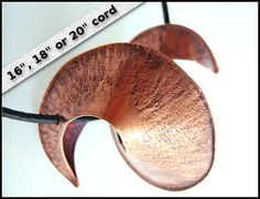 Love the 3D sculptural nature of this pendant.  Handmade copper unisex pendant necklace by TheCraftyDwarf on Etsy