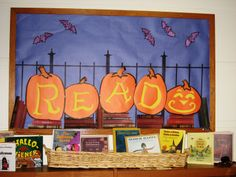 Book display; centerpiece for kids' art display - surround with jack-o-lanterns created by library kids