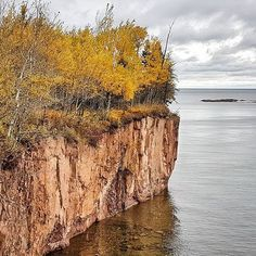 Loving the Lake Superior views and pink coloured cliffs while biking the Gitche-Gami Trail in Minnesota #OnlyinMN #lakesuperior