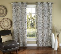 Enliven your favorite room with these curtain panels that display rich hues and an intricate pattern.Includes two panelsGrommet100% polyesterMachine wash; hang dryImported