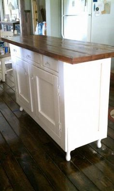 Hutch turned into a kitchen island. We have one of these! And, my husband has been wanting to throw it out. Not anymore! Doing it.