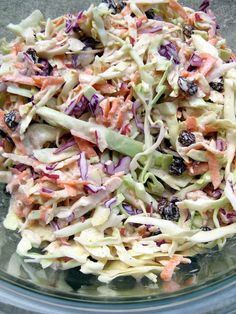 a hint of honey: Spiced Apple-Raisin Coleslaw.  3 cups green cabbage, shredded,  1 cup red cabbage, shredded,  1 large Fuji apple, cored and grated,  2 carrots, peeled and grated,  1/3 cup raisins,  1/4 cup mayonnaise,  1/4 cup plain Greek yogurt,  2 Tbsp. cider vinegar,  1 tsp. organic cane sugar,  generous 1/2 tsp. allspice,  salt and freshly ground black pepper, to taste