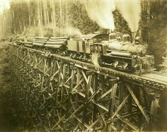Washington State Historical Society - Darius Kinsey - Log train for the Northwest Lumber Company on trestle with engineer, fireman and one other worker at the Shay locomotive.