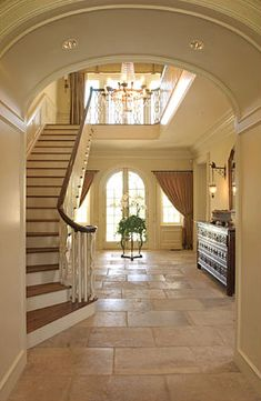 From Elegant Homes Blog. Love this big, clean entry.  Entry foyer and stairs.  Entry foyer and stairs. French English country traditional