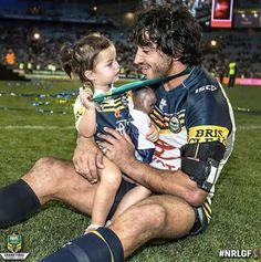 Johnathan Thurston, co-captain of 2015 NRL Premiers North Qld Cowboys shares a precious moment with his daughter after the teams amazing win Sunday October. Johnathan Thurston, Cowboys Win, Brisbane Broncos, Proud Wife, Rugby League, Career Coach, Home Team, Sports Stars, Best Player