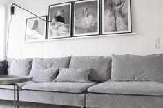 Cool Scandinavian inspired living room with a grey velvet sofa |black and white photo art | IKEA Söderhamn sofa with a Bemz cover in Zinc Grey Zaragoza Vintage Velvet