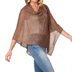 Linen Poncho This 100% linen poncho / dress topper is THE SOLUTION to so many of our spring and summertime wardrobe needs. It is slightly transparent and covers the upper arm area without over heating. Hands free and nice to drape. Whether worn casually or for an occasion...IT IS PERFECT! 100% (almost) wrinkle free linen Made in Italy  And this baby folds up into almost nothing for easy carrying in a relatively small cross body bag.