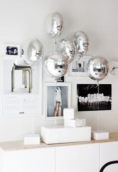 love the silver balloons for a birthday | via A Merry Mishap