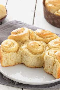 Buttery Sourdough Buns Recipe  - These soft dinner rolls are at the opposite end of the texture spectrum. Buttery spirals with a pleasingly mild sourdough tang, they're soft on the inside, but sport a wonderfully crisp crust — think crescent roll. And, like a crescent roll, they're fun to unravel and enjoy bit by buttery bit!