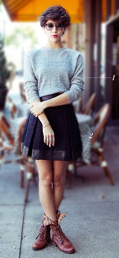 Love everything about this. Her hair. Her glasses. Her chunky sweater. Her fantastic skirt. Her grunge shoes.