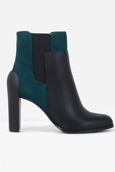 The Subtle Colorblock It's not until you see this puppy from the side that the teal suede really emerges. It's a cool way to add a rich hue amidst a typical fall palette of burnt oranges and browns.  Charles & Keith Duo-Tone Ankle Booties, $99, available at Charles & Keith.