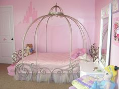 little girls bedroom with carriage-shaped canopy bed