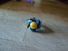 Spiral top woven beaded ring. Yellow swirl ring. by StrungOnLove on Etsy