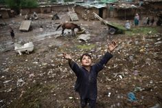 An Afghan #refugee boy chases bubbles while playing on the outskirts of #Islamabad, #Pakistan. Photographs: Muhammed Muheisen/AP