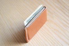 Hand stitched minimal bussines card holder. Made from a single piece of 5oz premium full-grain leather from Horween tannery. Two separate slots for 4-6 plastic cards or cash. Perfect fit and small size, so this wallet will be almost invisible in your pocket. Edges are polished and painted