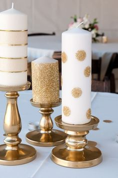 Life with Fingerprints: Use glue dots and add glitter to Ikea candles, spray paint Ikea candle holders DIY wedding ideas and tips. DIY wedding decor and flowers. Everything a DIY bride needs to have a fabulous wedding on a budget! Diy Candle Holders Wedding, Ikea Candle Holder, Candlestick Holders, Ikea Candles, Pillar Candles, Glitter Candles, Gold Glitter, Gold Candles, Luxury Candles