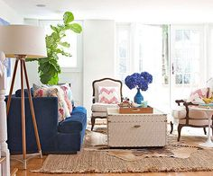 One trick to a beautiful living room, no matter what you style, is layering. See the tricks for this living room and others by clicking here: http://www.bhg.com/rooms/living-room/room-arranging/living-room-designs/?socsrc=122714layeredlivingroom&page=5