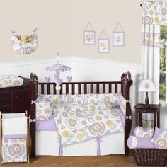 Lavender and White Suzanna 9 pc Crib Bedding set has all that your little bundle of joy will need. Let the little one in your home settle down to sleep in this incredible nursery set. This baby girl bedding set features a gorgeous floral print, a coordinating mini dot, and crisp white cotton. This collection uses the stylish colors of lavender, white, gray, and yellow.