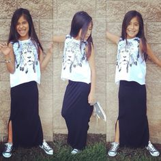 Graphic top paired with a maxi skirt. Shoes : converse