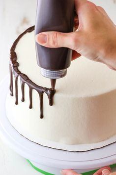 Learn to make a Chocolate Drip Cake with this easy method! All you need is chocolate ganache, a frosted cake and a few simple tools. You'll be on your way to an impressive yet easily decorated cake in no time! How to Make a Chocolate Drip Cake Drip Cake Recipes, Easy Cake Recipes, Cheesecake Recipes, Frosting Recipes, Easy Cake Decorating, Cake Decorating Techniques, Decorating Ideas, Cake Decorating For Beginners, Cake Decorating With Fondant
